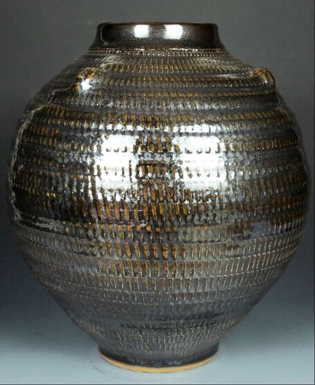 Lidded vase with crystal matte and shino glaze